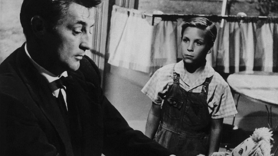 1955's The Night of the Hunter, starring Robert Mitchum as a very bad preacher, is a classic of the Southern Gothic genre (Credit: Alamy)