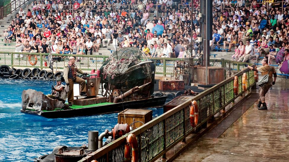 The Waterworld film attraction, such as this one in Singapore, has been one of the most popular at the Universal Studios theme parks (Credit: Alamy)