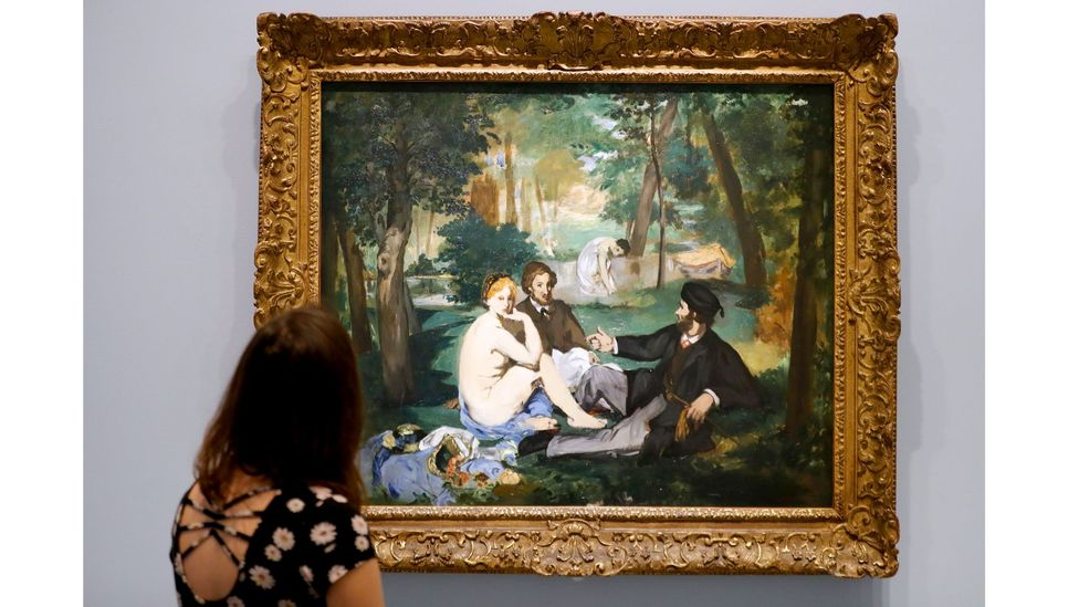 Another of ArtActivistBarbie's subjects is Manet's Le Déjeuner sur l'Herbe, where a female nude is accompanied by two fully-clothed men (Credit: Getty Images)