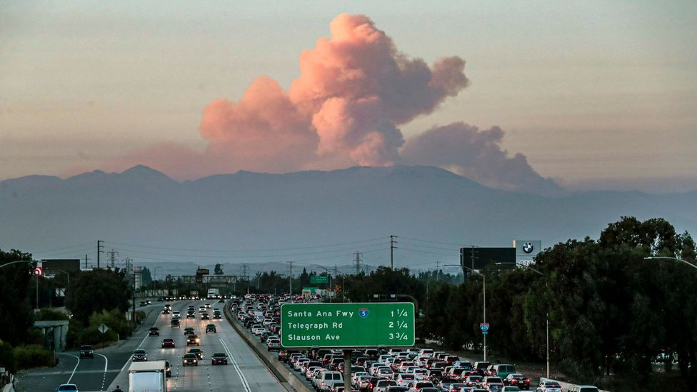 A wildfire cloud looms over Californian traffic, earlier this month (Credit: Getty Images)