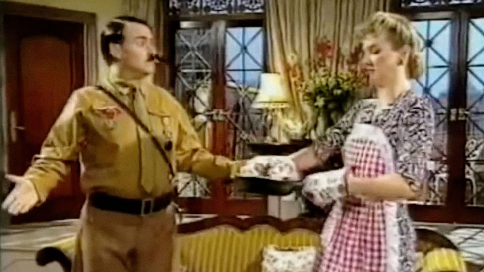 The premise of Heil Honey I'm Home! saw Hitler and Eva Braun clash with their Jewish next door neighbours in a stylised parody of 1950s US sitcoms (Credit: Sky)