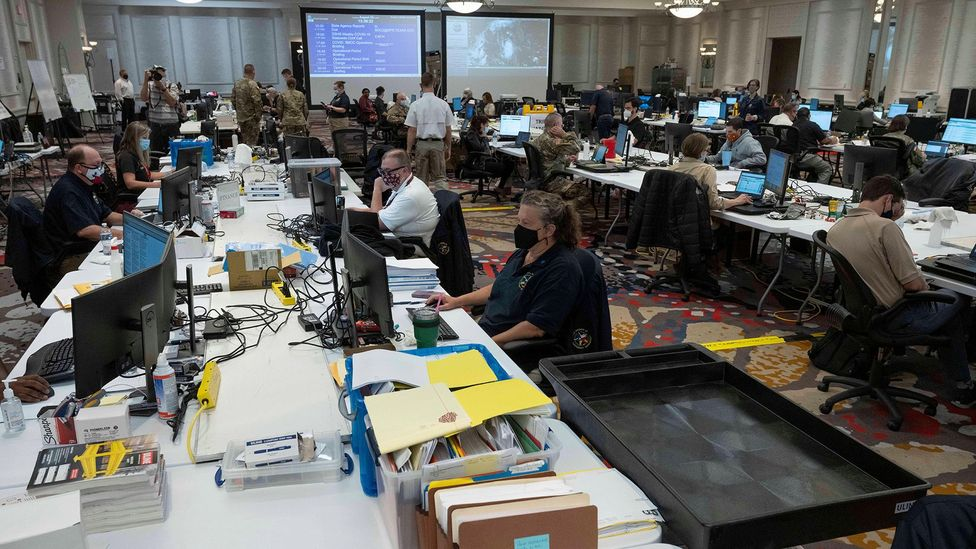 Workers at the Texas Emergency Operations Center in Austin in August. Some workers must continue to show up in person in an office, even during Covid-19 (Credit: Alamy)