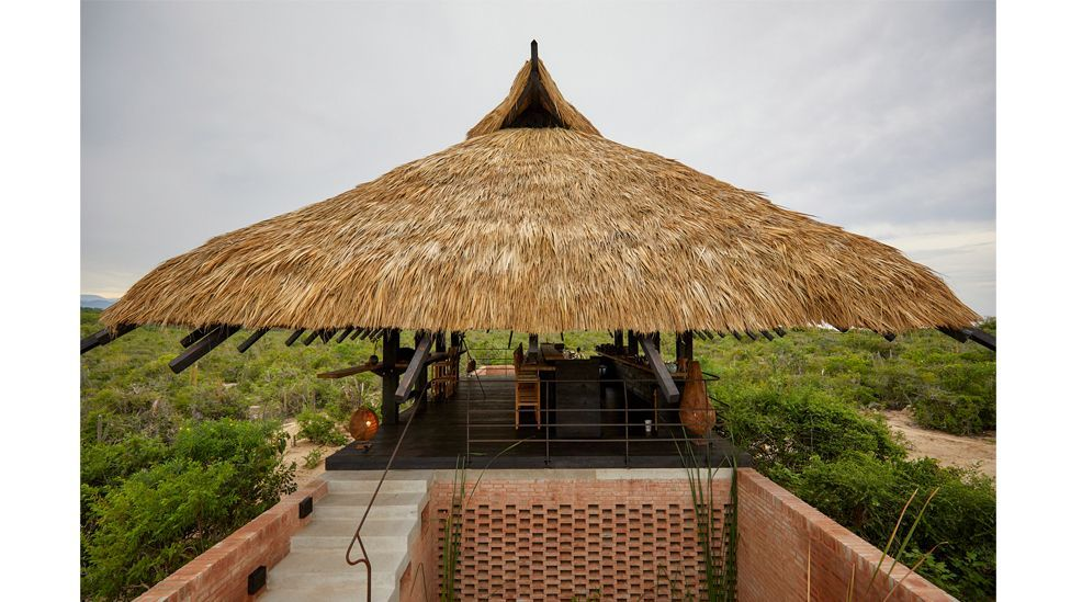The outdoor Kakurega Omakase on the Pacific coast of Mexico is a thatched refuge (Credit: TAX Architects/ Sergio Lopez)
