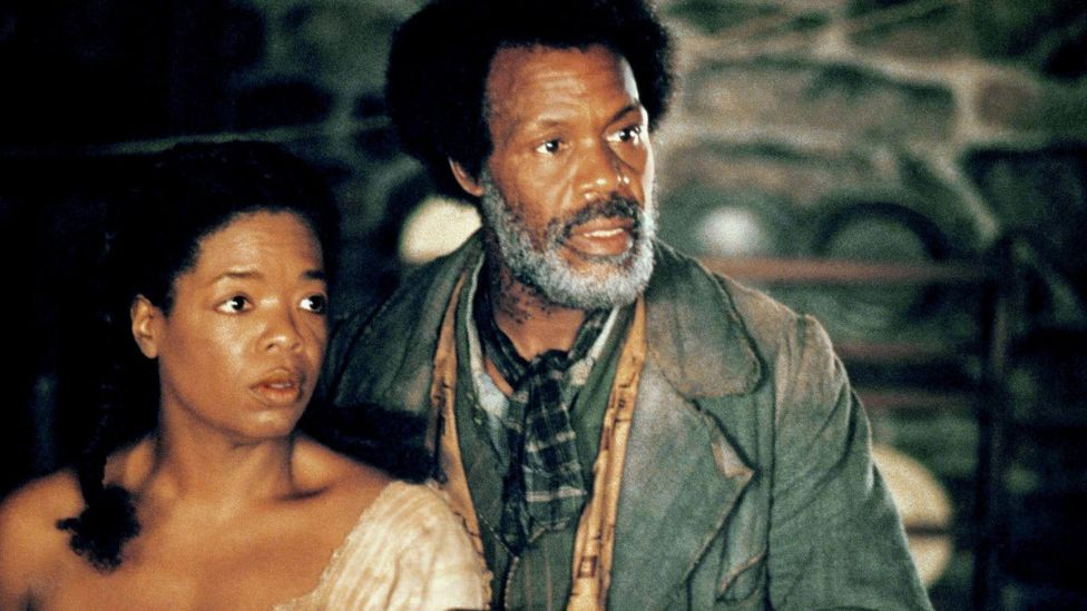 The 1998 film adaptation of Beloved starred Oprah Winfrey as Sethe, with Danny Glover as Paul D (Credit: Alamy)