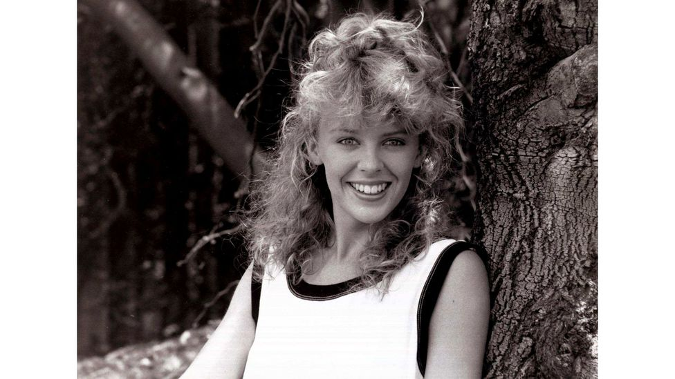 Kylie first found fame playing spunky mechanic Charlene Mitchell in Australian soap opera Neighbours (Credit: Alamy)