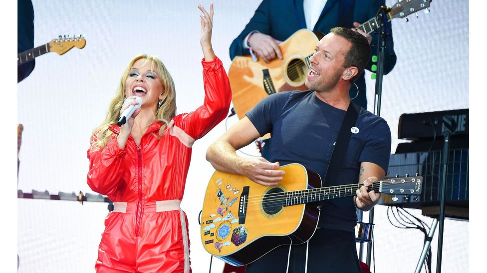 Kylie cemented her international treasure status with her set at last year's Glastonbury, which included a guest appearance by Coldplay's Chris Martin (Credit: Alamy)
