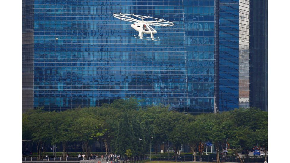 A Volocopter air taxi performs a demonstration in Singapore in October 2019 (Credit: Reuters)