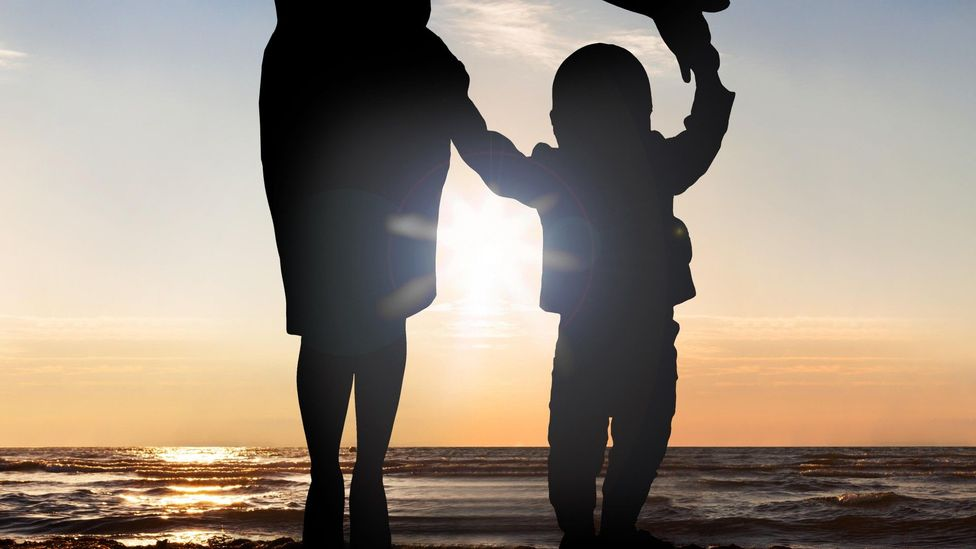 File image of the silhouettes of a mother and child