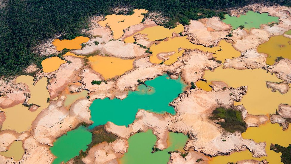 Elsewhere in the Amazon, in Peru, a deforested area caused by illegal gold mining in the river basin of the Madre de Dios (Credit: Cris Bouroncle/Getty Images)
