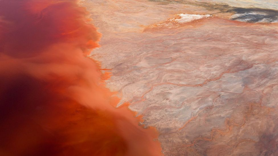 When the minerals meet air, they redden, and then darken as they collect in deeper waters (Credit: Peter Adams/Getty Images)