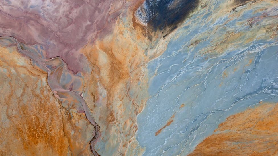 Mixed with water, the iron minerals spread like watercolour paint across the landscape (Credit: Peter Adams/Getty Images)