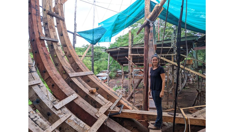 Danielle Doggett, Sail Cargo's co-founder and managing director, inspects the progress of Ceiba's construction from inside the hull (Credit: Jocelyn Timperley)