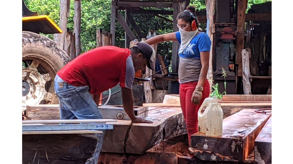 Locals such as Jamilet Espino Castillo (right) have found opportunities to learn new skills on the shipyard – such as carpentry (Credit: Jocelyn Timperley)