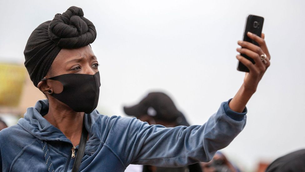 activist woman with phone