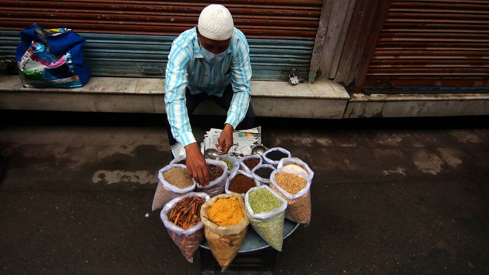 A street seller with bags of spices (Credit: Getty Images)