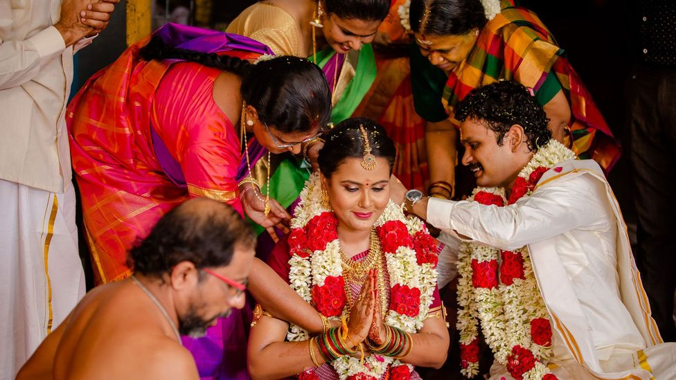 Although some couples are scaling back their large Indian weddings, others are keeping ceremonies just as lavish – but in a different way (Credit: Aju Photography)