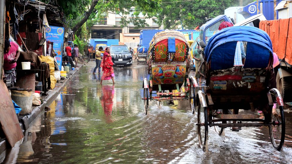 Flooding is a regular part of life in Dhaka, but the city is being adapted to survive the more extreme floods of the future (Credit: Getty Images)