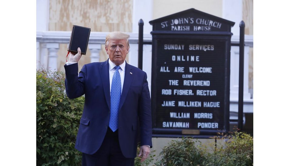US President Donald Trump poses with a Bible outside St Johns Church in Washington DC (Credit: Shawn Thew/EPA)