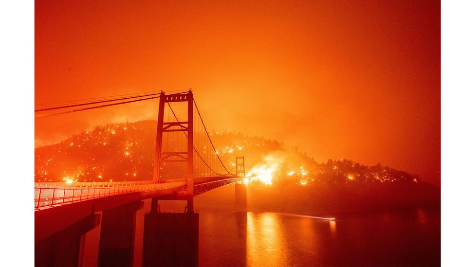The Bidwell Bar Bridge is surrounded by fire in Lake Oroville, California, September 2020 (Credit: Josh Edelson/AFP via Getty Images)