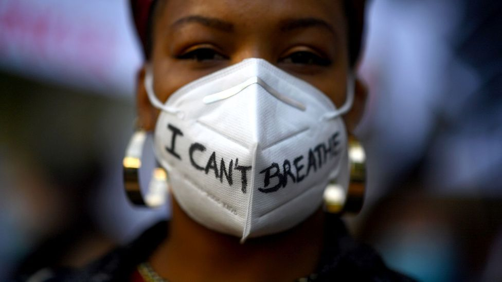 """A woman wears a mask reading """"I can't breathe"""" in Madrid, on 7 June, 2020, during a demonstration against racism and in solidarity with the Black Lives Matter movement"""