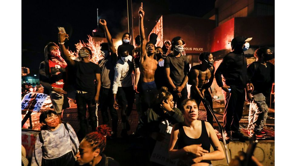 Protesters demonstrate beside a police station in Minneapolis, Minnesota on 28 May, 2020, after the death of George Floyd in police custody (Credit: John Minchillo/AP)
