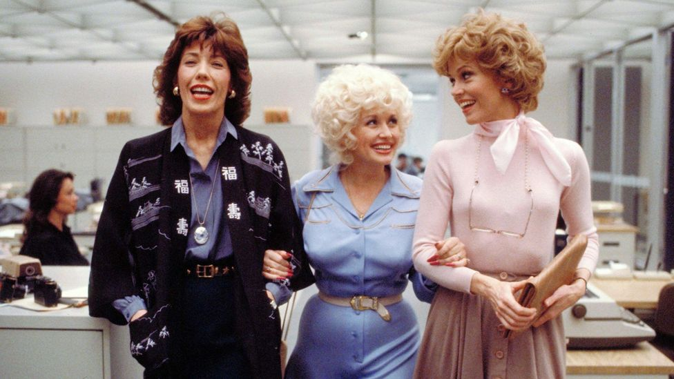 Parton stayed close to her 9 to 5 co-stars Lily Tomlin and Jane Fonda; the film was later made into a musical (Credit: Alamy)