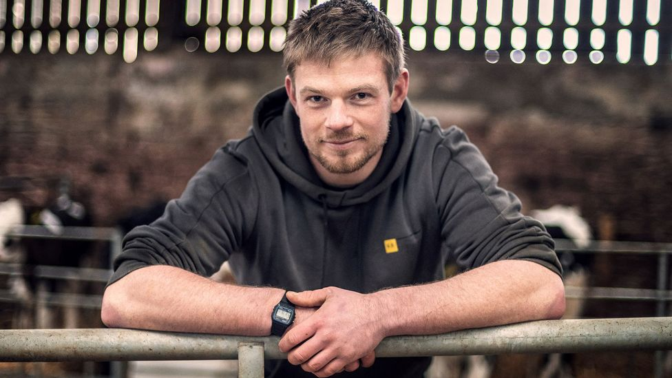 Ben Davies is determined that dairy farming can adapt to climate change, reducing its emissions substantially (Credit: John Quintero/BBC)