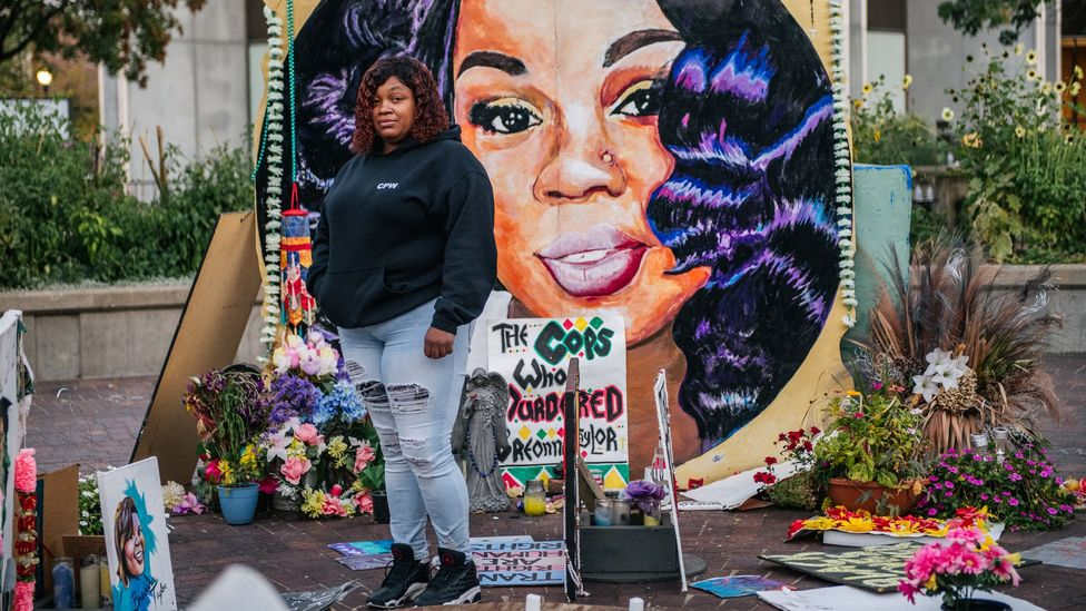 Tamika Palmer, the mother of Breonna Taylor, stands in front of a mural of her daughter in Louisville, Kentucky (Credit: Brandon Bell/ Getty Images)