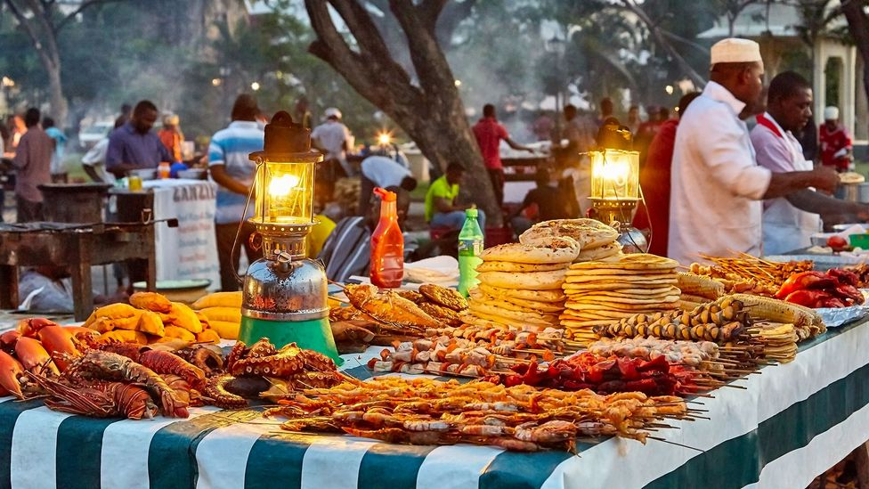 Stone Town's Forodhani Gardens market is filled with vendors preparing freshly made Swahili cuisine (Credit: Peter Unger/Getty Images)