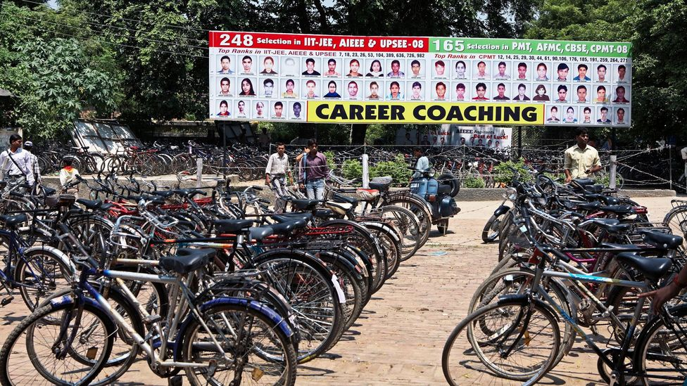 A busy coaching centre in the city of Lucknow advertises the successes of its former students (Credit: Alamy)