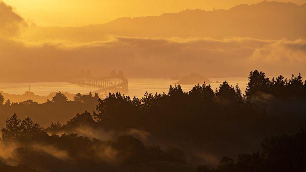 Clearing fog over mountains and the Richmond-San Rafael Bridge in San Francisco Bay