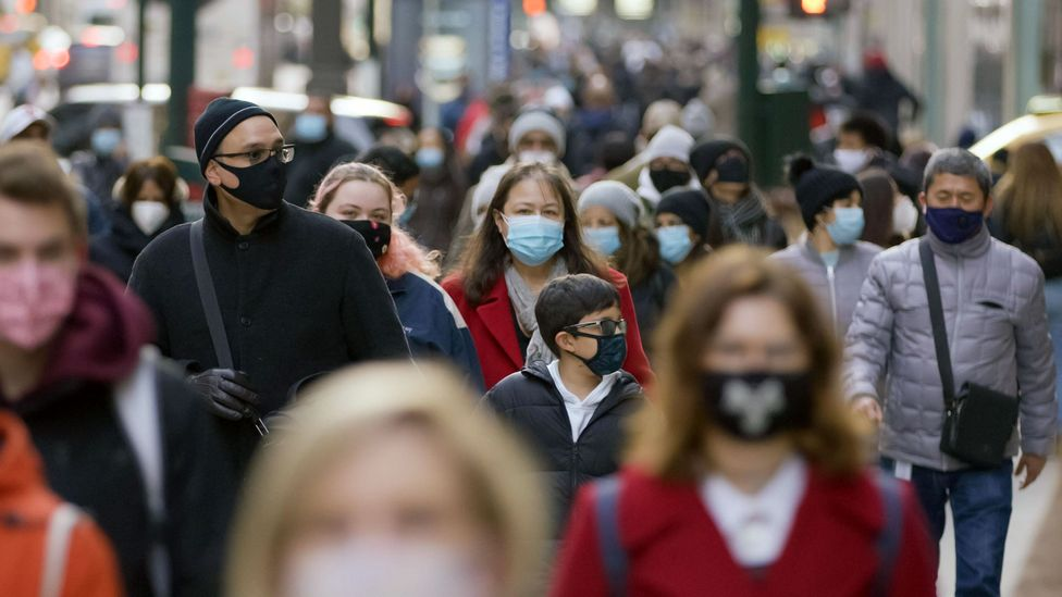For some, masks serve as both a psychological and physical safety barrier, helping wearers blend in and subvert judgement about their appearances (Credit: Alamy)