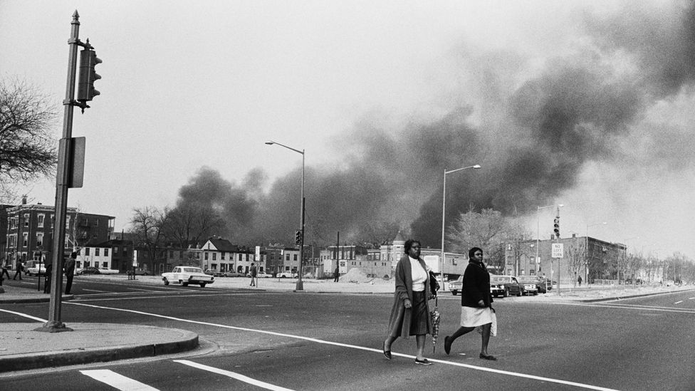 Smoke rises above Washington DC following the assassination of Martin Luther King in 1968 (Credit: Getty Images)