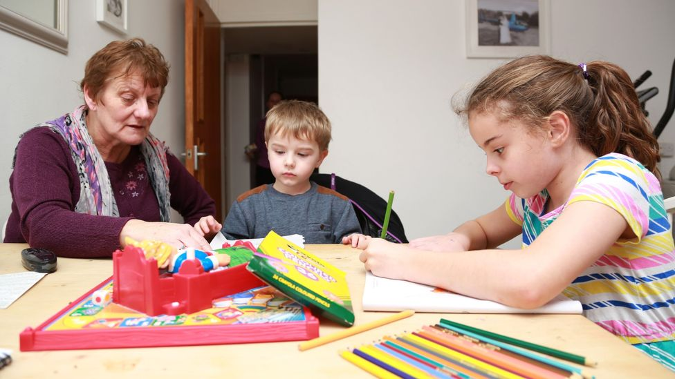 In some families, grandparents are playing a key role looking after children so their parents can work (Credit: Alamy)