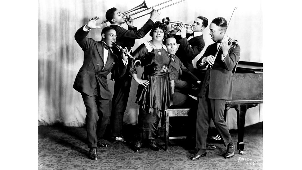 Mamie Smith, pictured with her band the Jazz Hounds, was the first black singer to make a record (Credit: Getty Images)
