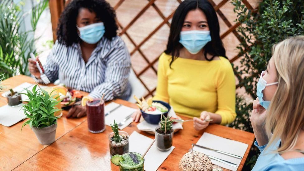 In countries in which the virus is under control, masked socialising is helping things feel like they're returning to normal (Credit: Alamy)