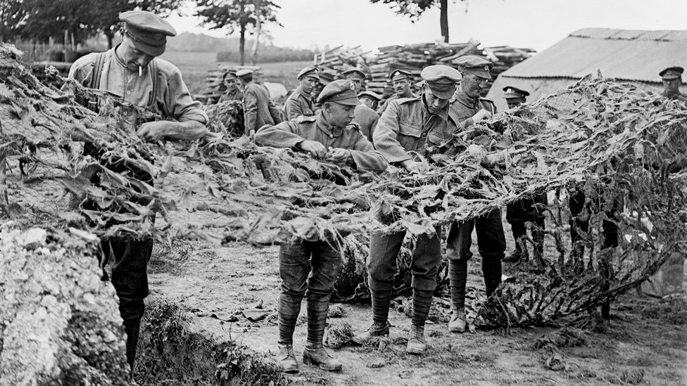 Soldiers making camouflage netting in Basseux, 16 June 1918 (Credit: Lt J W Brooke/ Imperial War Museums via Getty Images)