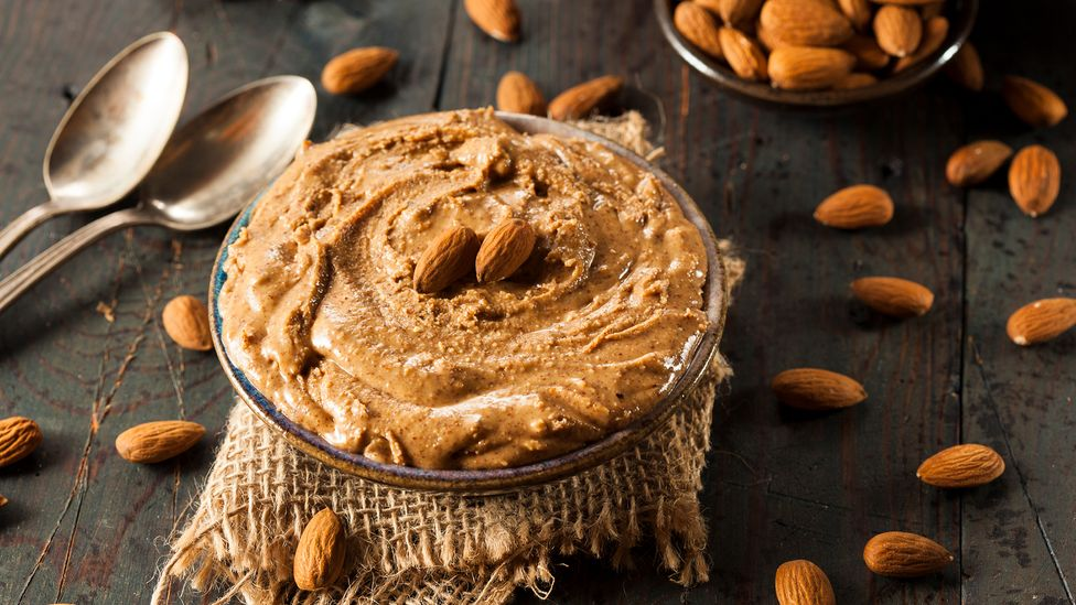 Almond butter has been considered more healthy than butter made from peanuts (Credit: Bhofack/Getty Images)