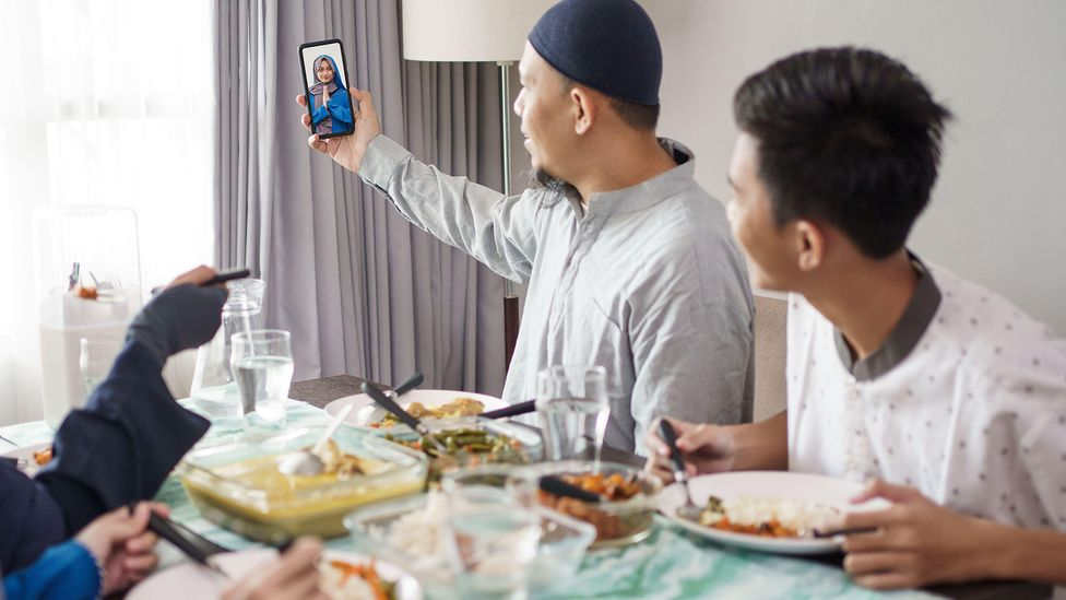 Doing something while you're Zooming, like preparing and sharing a family meal, can potentially minimise the unnatural-feeling, draining effects of video calls (Credit: Alamy)