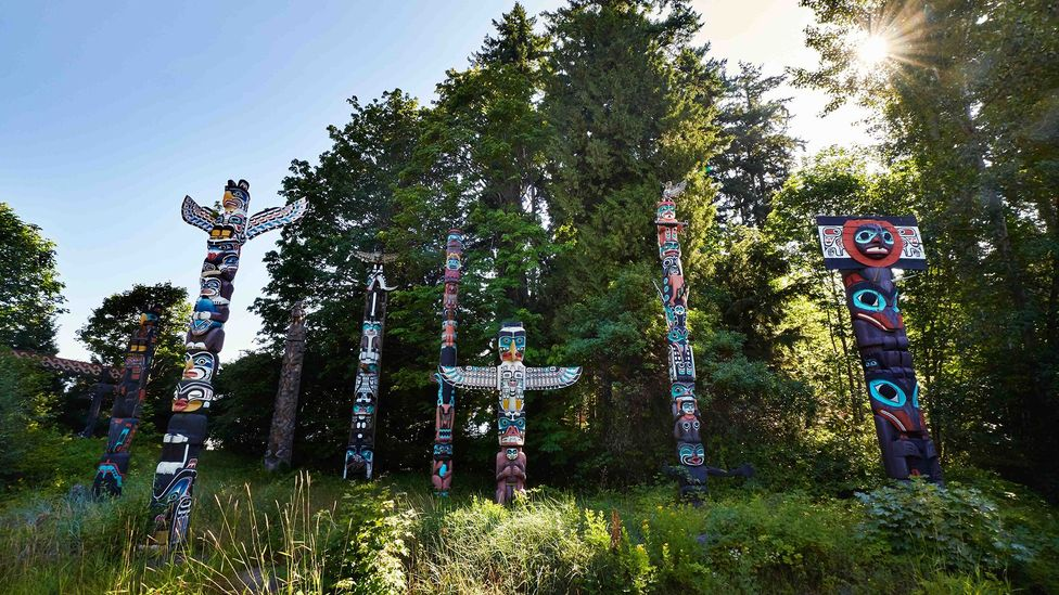 The totem poles in Vancouver's Stanley Park represent the city's rich Indigenous heritage (Credit: Simon Urwin)