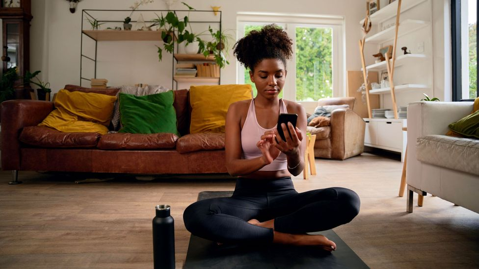Online fitness and meditation classes are among the newest workplace perks employers are rolling out, especially as employees work from home during the pandemic (Credit: Alamy)