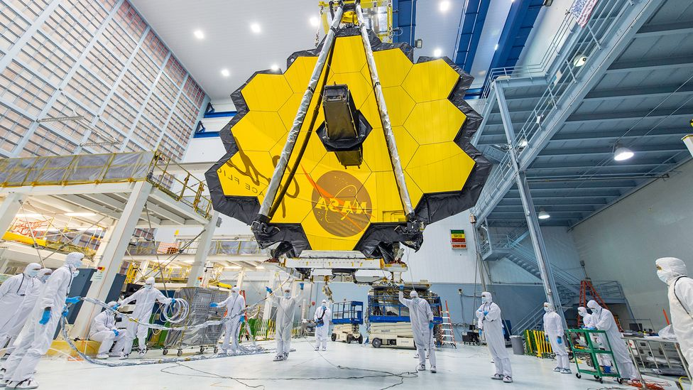 The James Webb Space Telescope's 18-segmented gold mirror will capture infrared light from some of the first galaxies that formed (Credit: NASA/Desiree Stover)