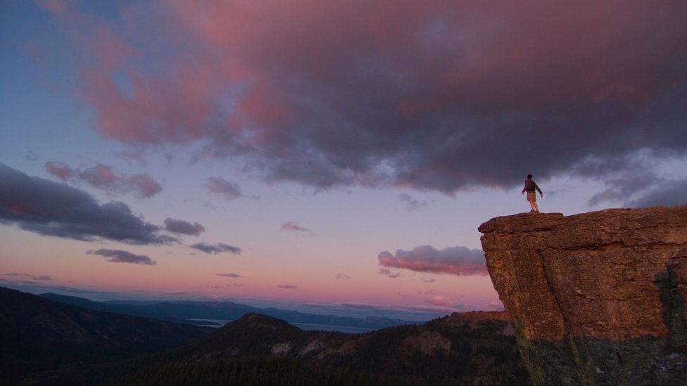 File image of a man on a cliff at sunset