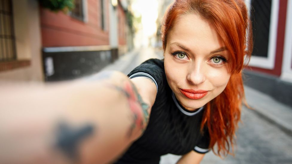 Constantly plastering selfies across social media may not mean the person is obsessed with themselves. In fact, it might mean they feel insecure about themselves. (Credit: Alamy)