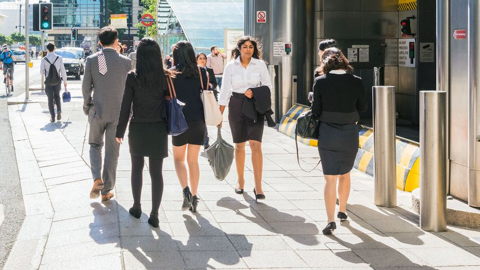 Young workers in industries including consulting and finance are used to spending lots of time in the office to prove themselves to higher ups (Credit: Alamy)