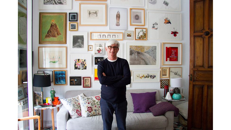 The walls of Fuentes's apartment are adorned from top to bottom with works by fellow artists (Credit: Araceli Martin Chicano)