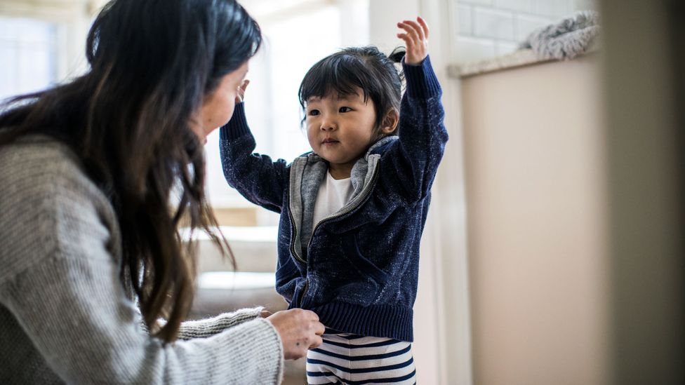 """Mothers doing tasks like picking a child's outfits are examples of """"maternal gatekeeping"""" – subtle tasks that fall to mums to take the lead on (Credit: Getty Images)"""