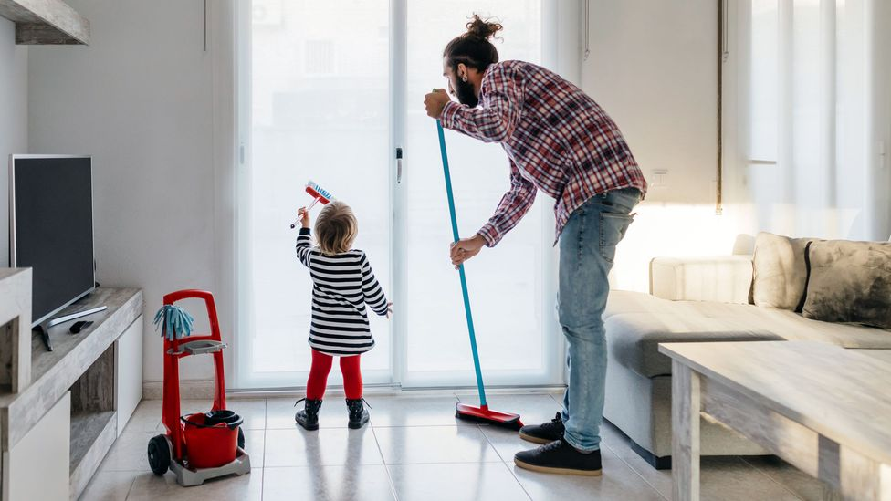 Men helping tackle hidden household labour that disproportionately falls on women could help lighten the load on mums, and create more equal households (Credit: Getty Images)