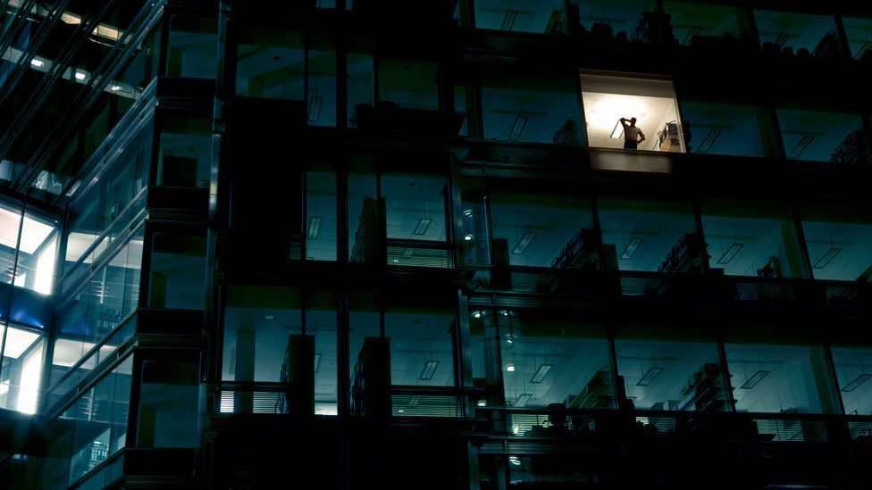 person working alone in skyscraper