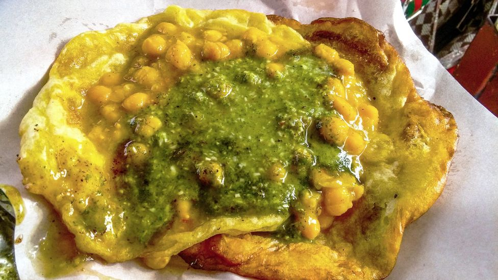 Doubles is a sandwich made from curried chickpeas tucked between two pieces of fried flat bread (Credit: Barry Ramkissoon/Getty Images)